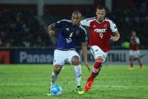 Johor Darul Ta'zim's Marcos Antonio protects the ball from South China's Nikola Komazec