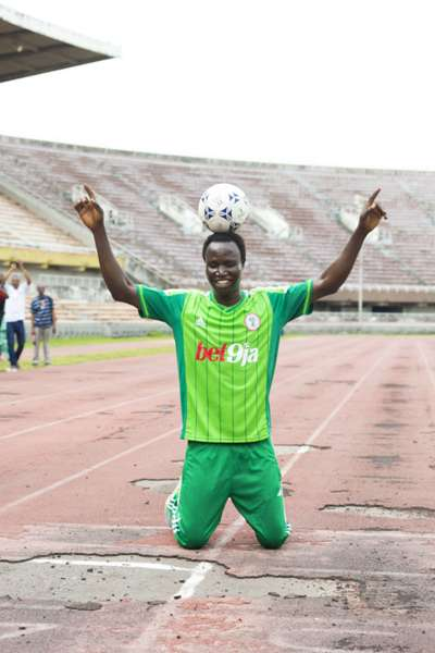 """Harrison Chinedu breaks record for """"farthest distance walked with a ball on the head""""."""