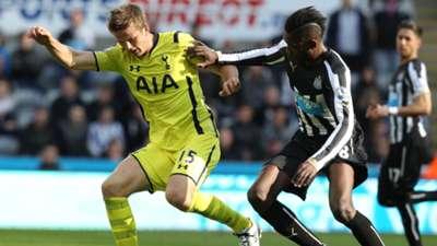 Eric Dier of Tottenham Hotspur and Sammy Ameobi of Newcastle United