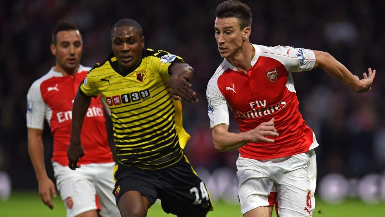 Odion Ighalo of Watford and Santi Cazorla & Laurent Koscielny of Arsenal