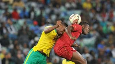 Thulani Hlatshwayo and Asamoah Gyan