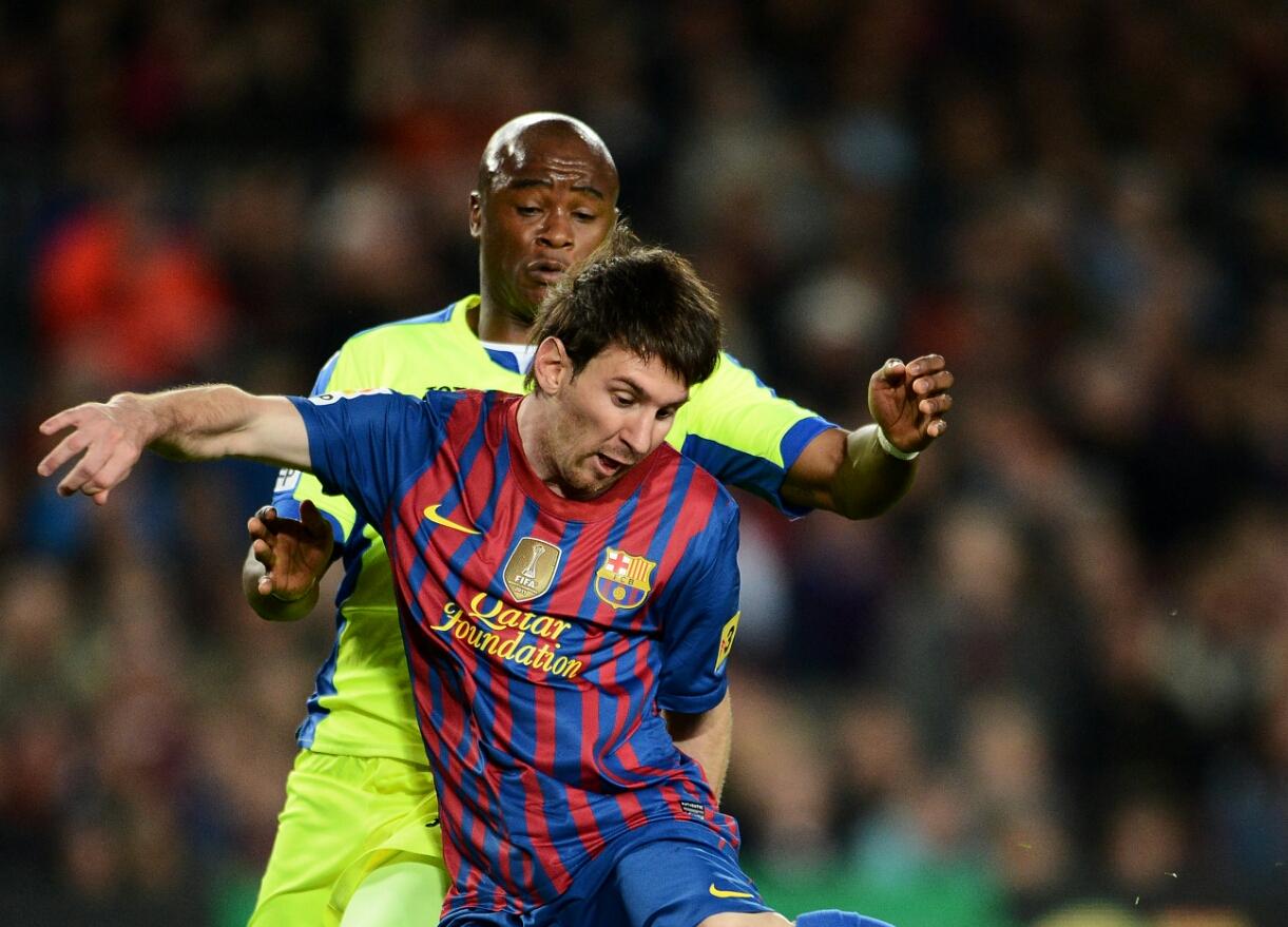 Tsepo Masilela and Lionel Messi