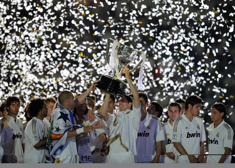 Cristiano Ronaldo of Real Madrid CF holds up the La Liga trophy 2012