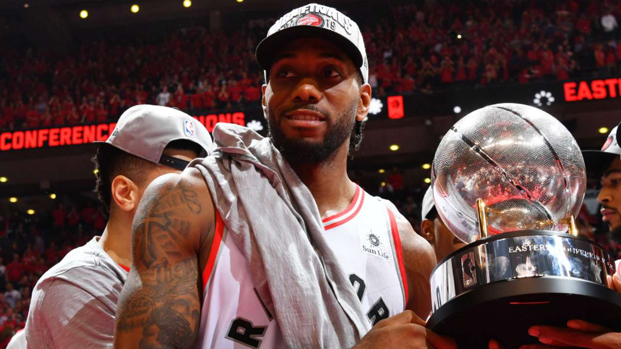 Kawhi Leonard holds the Eastern Conference championship trophy after clinching a spot in the NBA Finals.