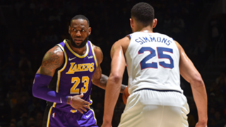 Ben Simmons defends LeBron James earlier this season.