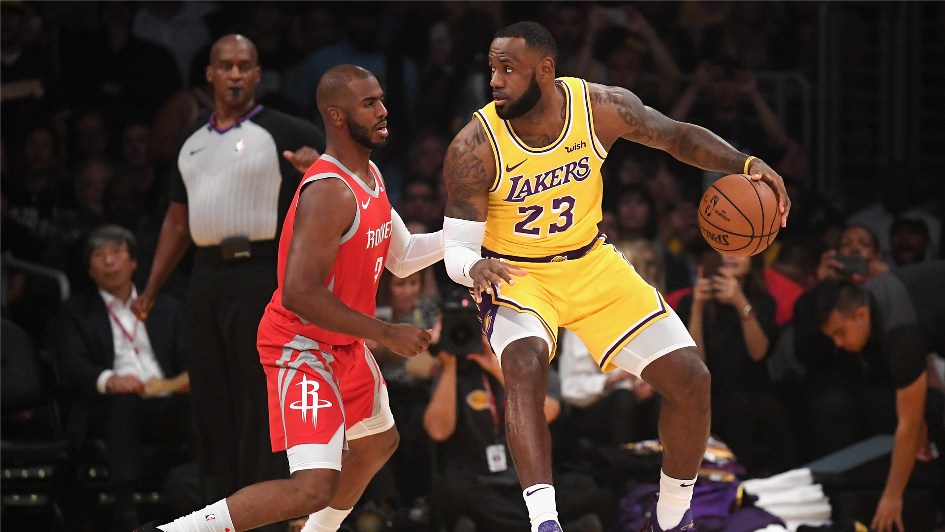 Chris Paul guards LeBron James