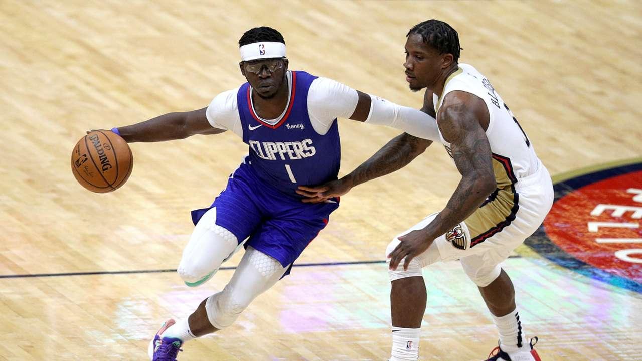 Eric Bledsoe defends LA Clippers guard Reggie Jackson