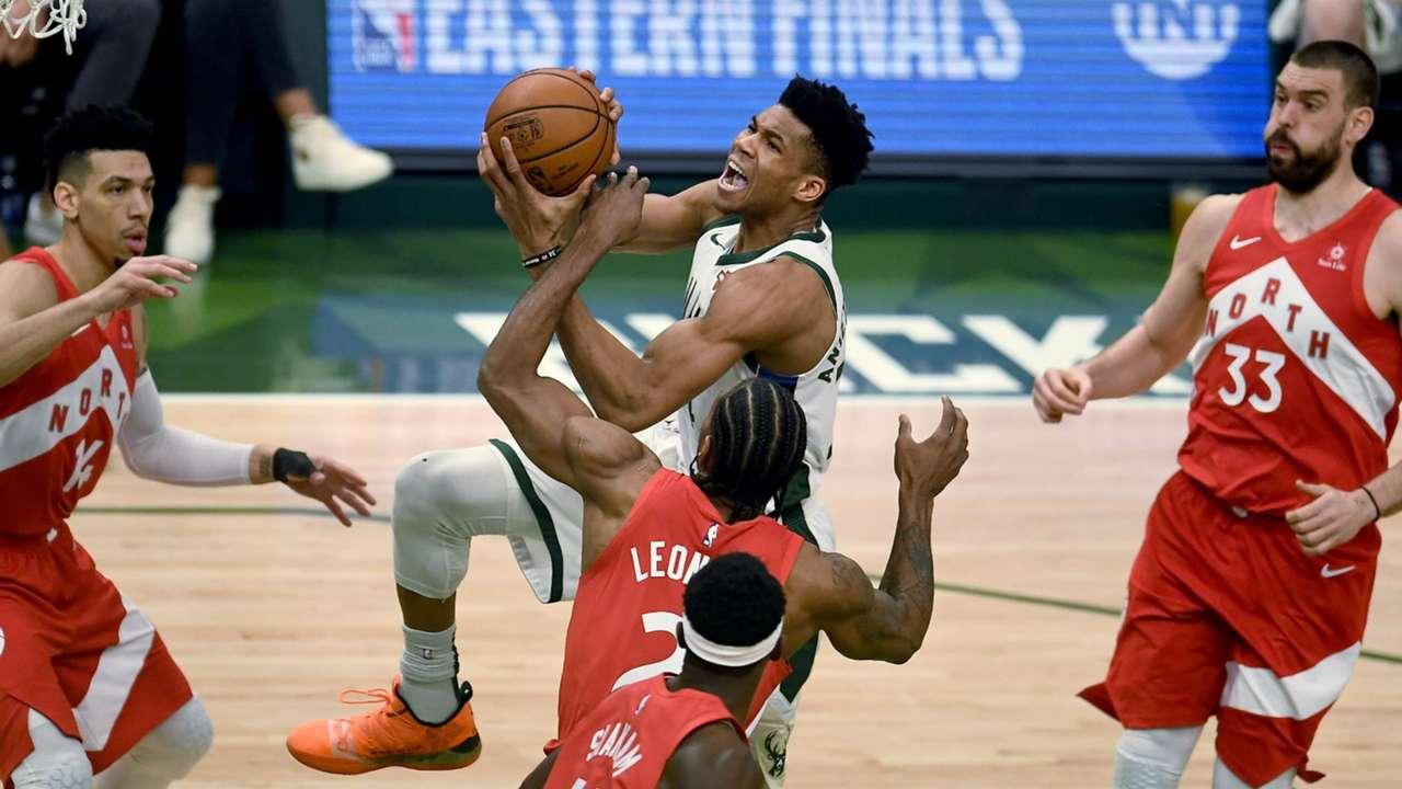 Kawhi Leonard fouls Giannis Antetokounmpo 15 seconds into Game 5.