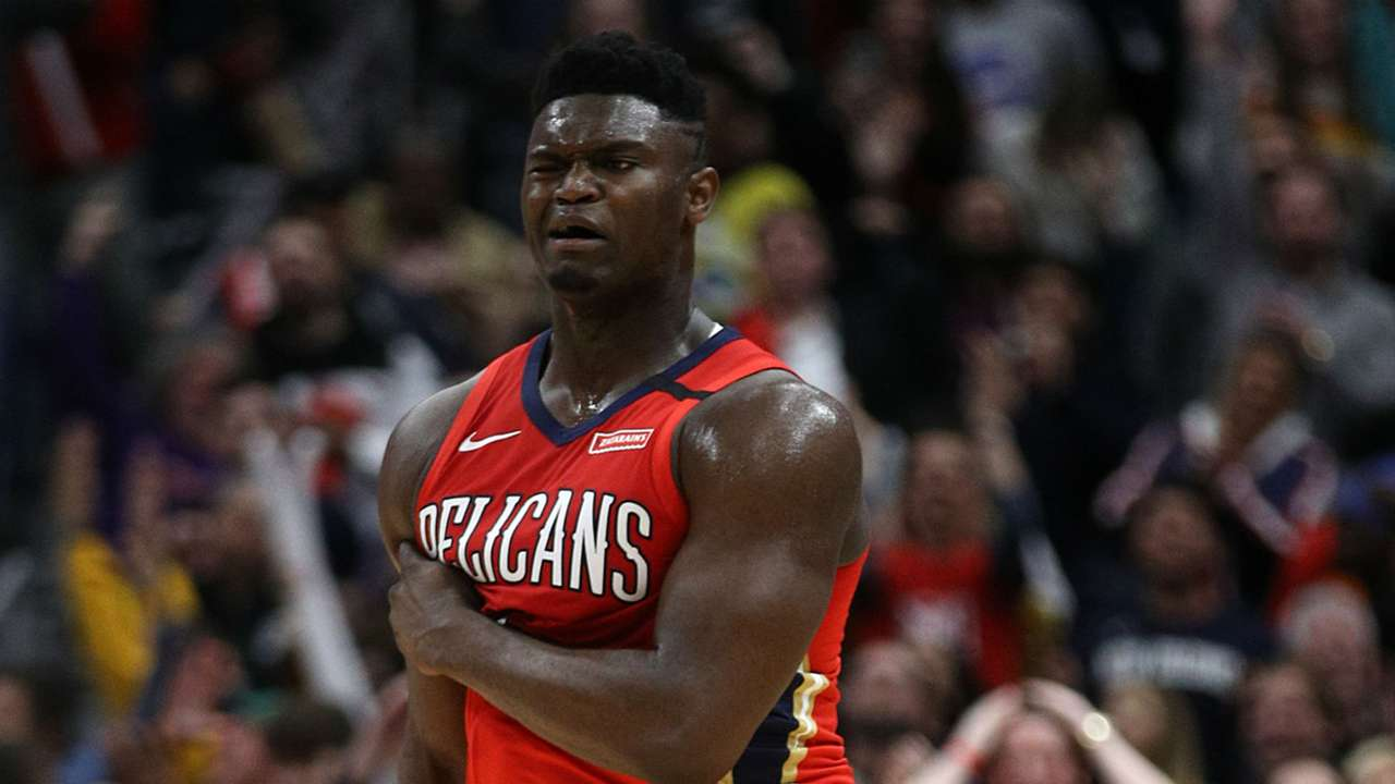 Zion Williamson reacts after making a 3-pointer in his debut.