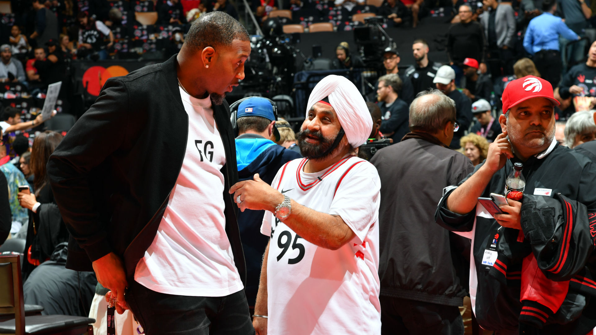 Nav Bhatia talks with Hall of Famer and former Raptor Tracy McGrady prior to Game 1 of the 2019 NBA Finals.