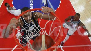 Rudy Gobert slams home two of his 26 points in the win over the United States.