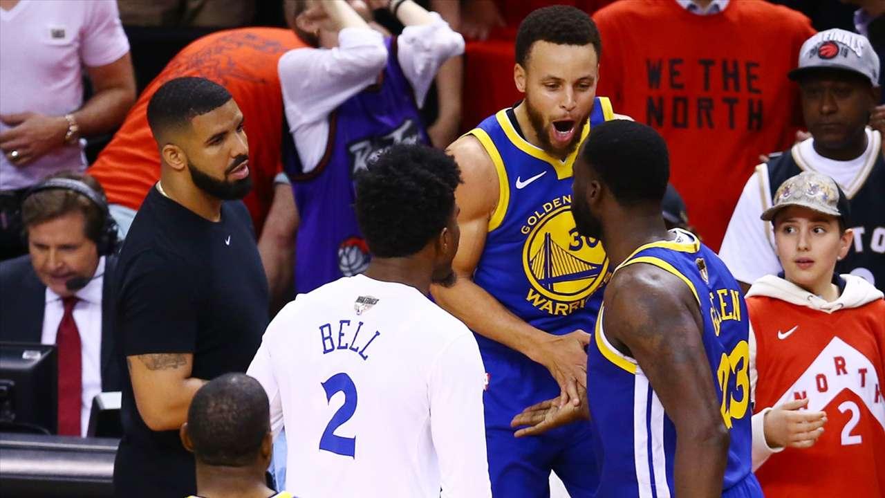 Stephen Curry and Draymond Green celebrate the Warriors' season-saving Game 5 win