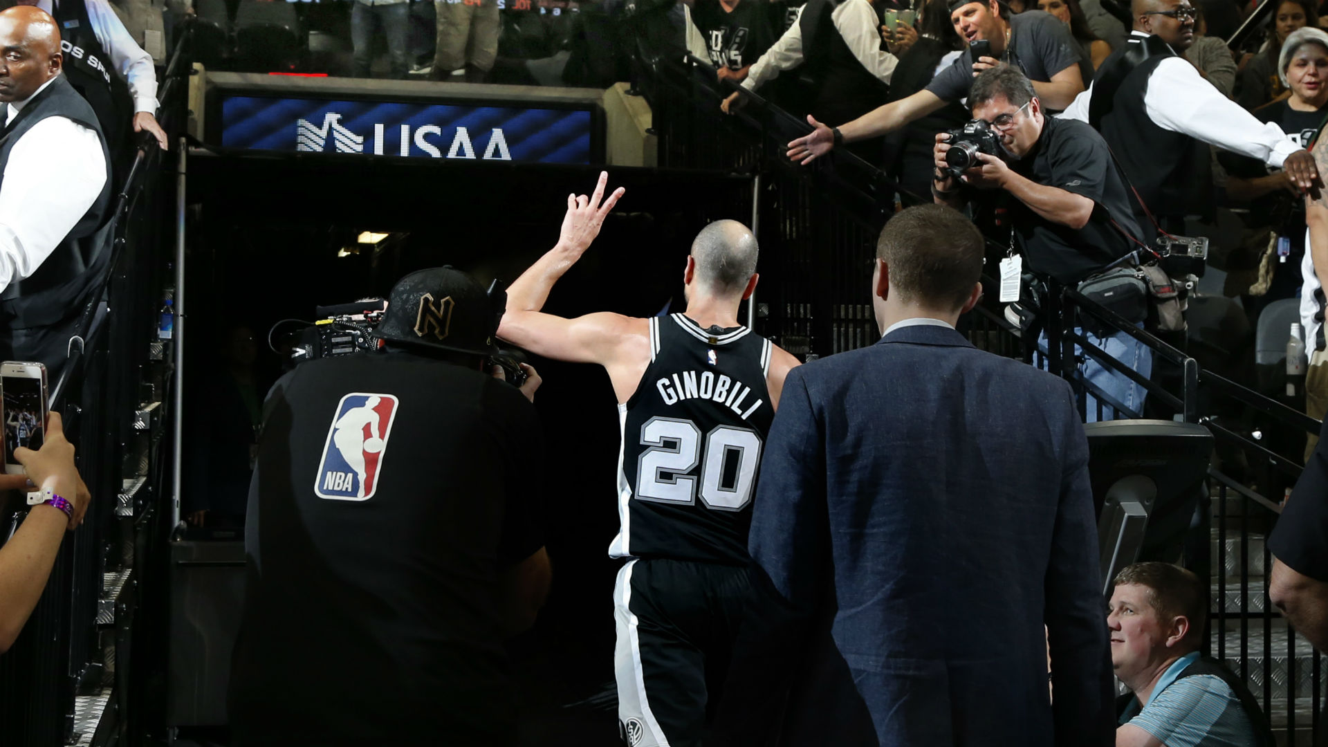 Manu Ginobili walks off the court after playing his final game in San Antonio