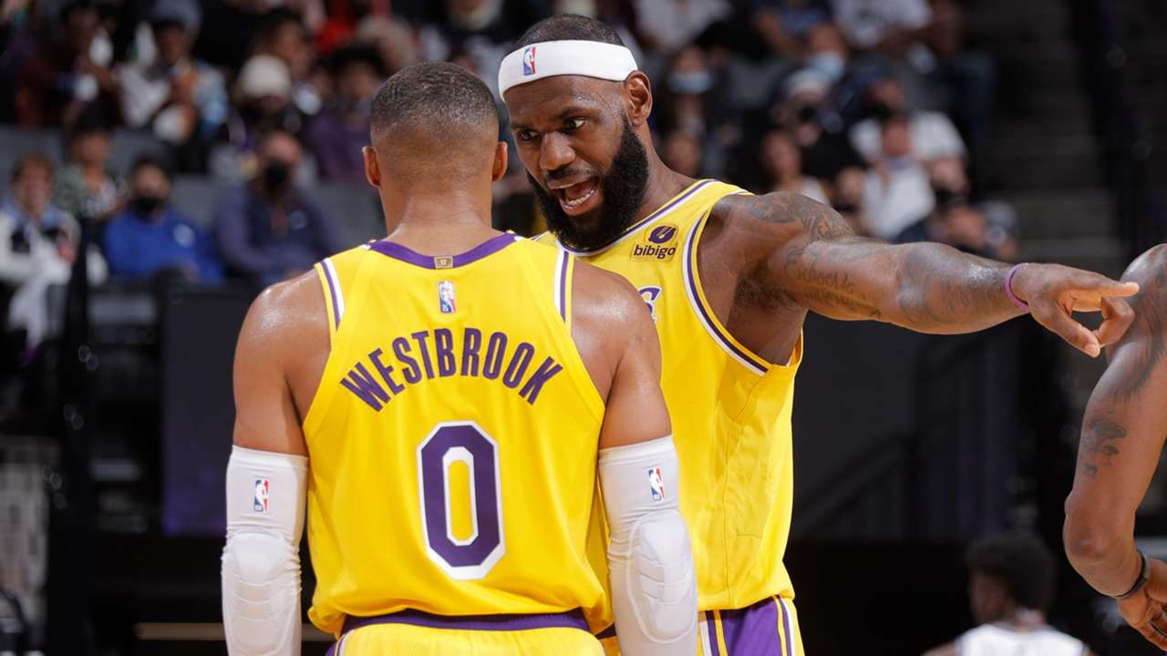 LeBron James and Russell Westbrook have a discussion during preseason.