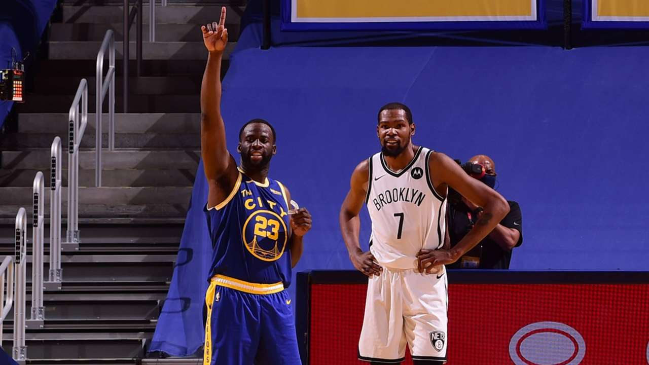 Draymond Green of the Warriors and Kevin Durant of the Nets