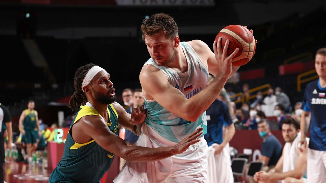 Patty Mills for Australia defends Slovenia's Luka Doncic