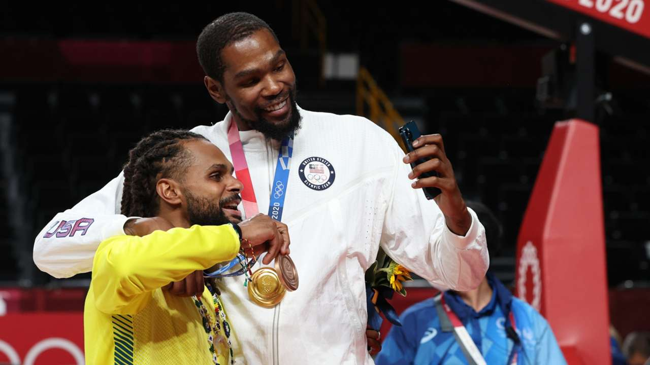 Australia's Patty Mills and USA's Kevin Durant