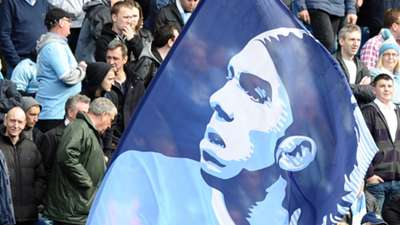 A flag showing the image of Manchester City's Argentinian forward Carlos Tevez on April 3, 2011