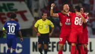 Kwon Kyung-Won (21) of UAE's Al-Ahli celebrates at the end of the AFC Champions League semi final football match against Saudi's Al-Hilal