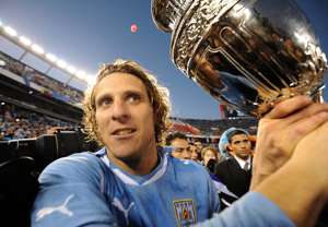 Diego Forlan holds 2011 Copa America trophy