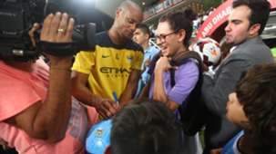 Manchester City player Vincent Kompany signs autographs for fan in UAE