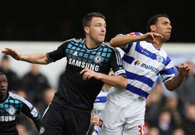 Terry competes for a header with Anton Ferdinand