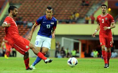 Malaysia vs Bahrain - 101513 - Fakri Saarani - Waleed Alhayam