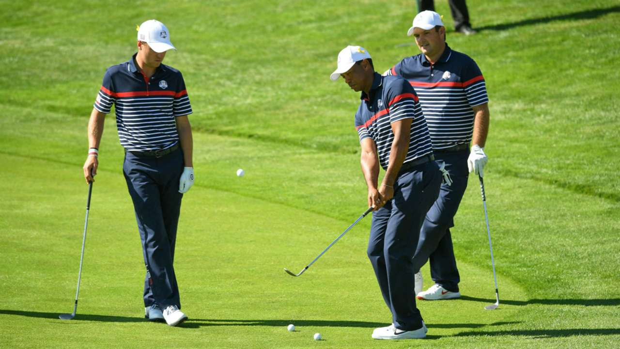 Justin Thomas, from left, Tiger Woods and Patrick Reed