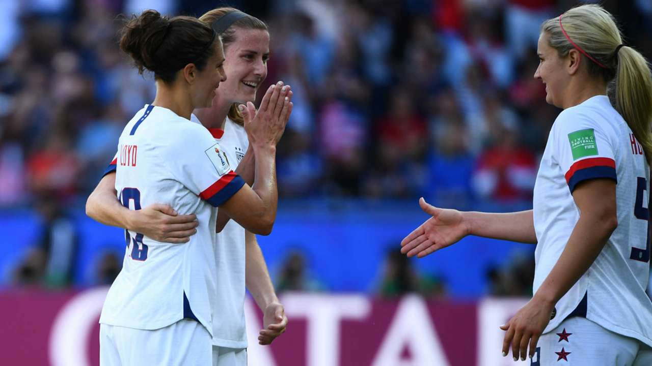 Carli Lloyd, left, politely celebrates