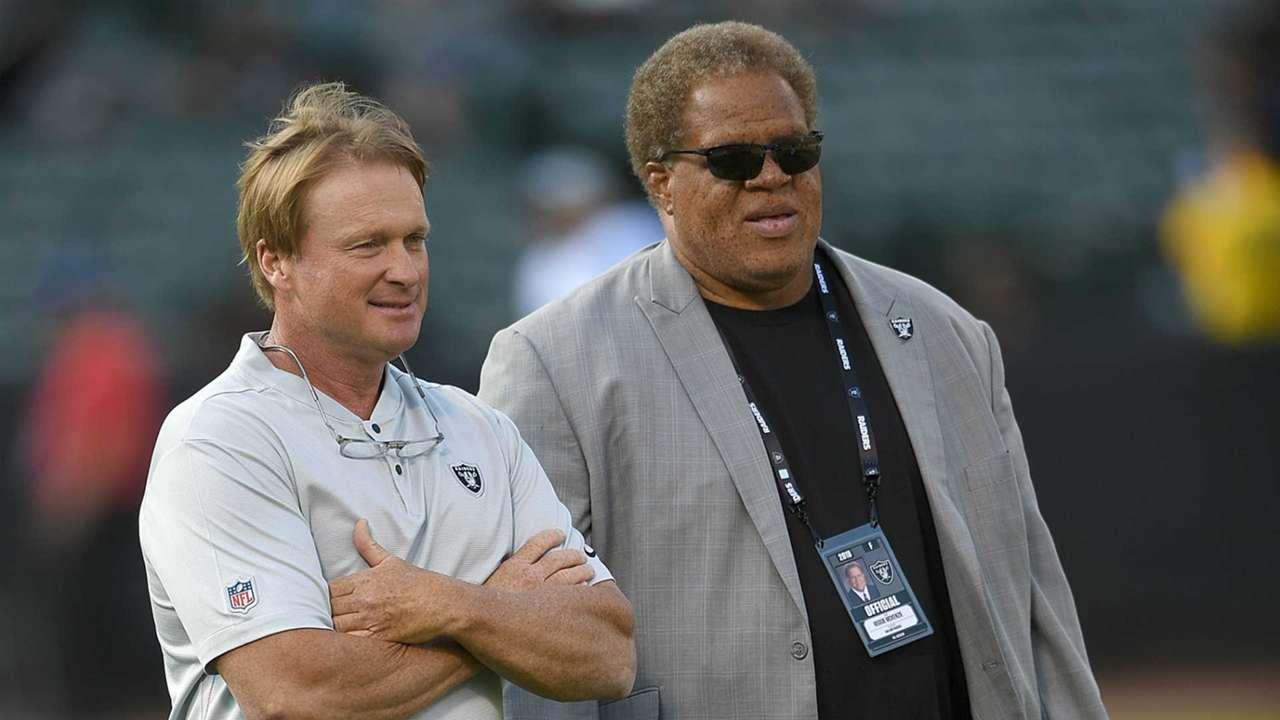 Reggie McKenzie, right, and Jon Gruden