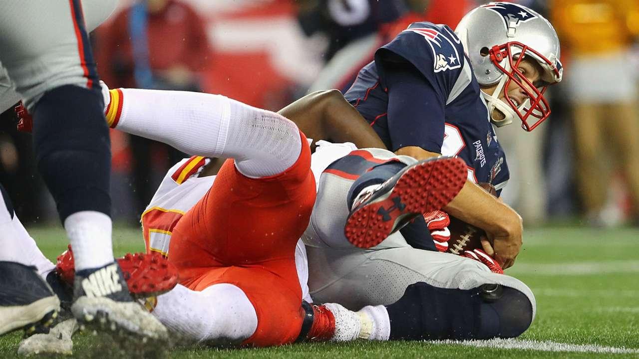 Tom Brady hits the turf