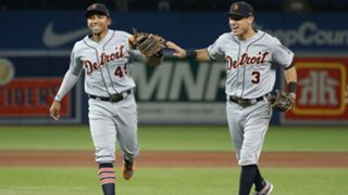 Dixon Machado (left) and Ian Kinsler celebrate triple play