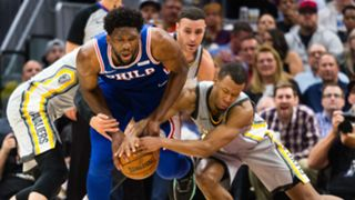 Joel Embiid and Rodney Hood fight for a loose ball