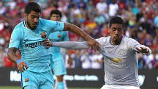 Luis Suarez Chris Smalling - cropped