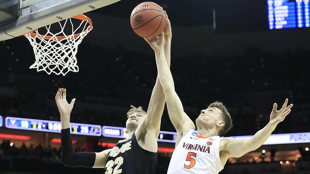Virginia's Kyle Guy battles Purdue's Matt Haarms