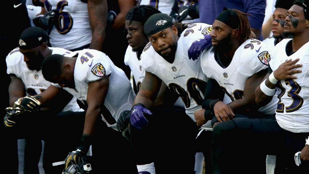 Ravens players kneel during national anthem