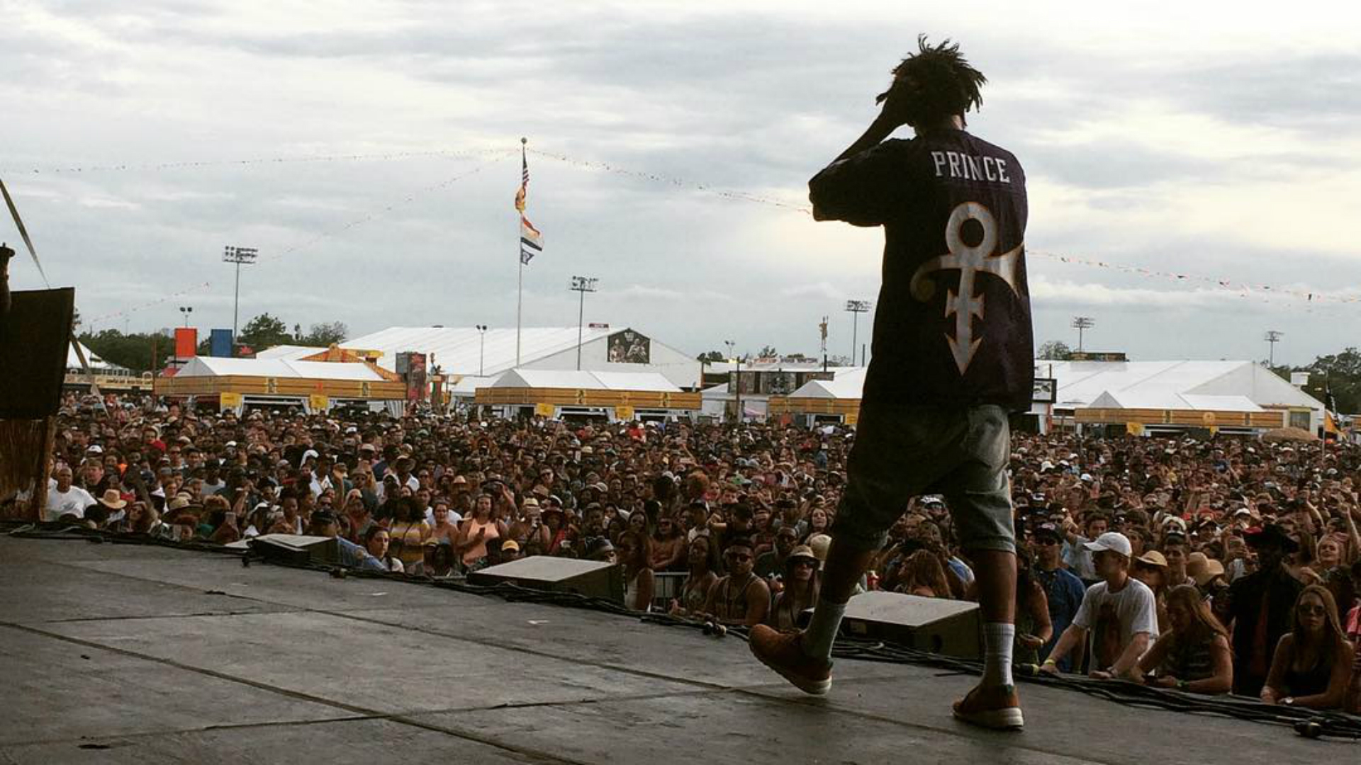 J. Cole honored Prince with custom Vikings jersey | Sporting News