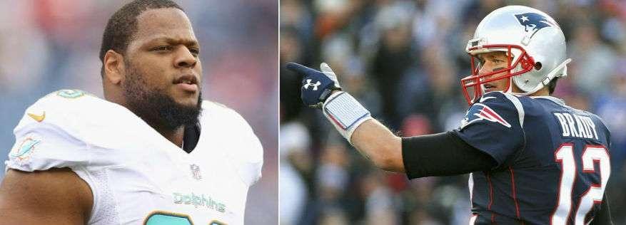 Ndamukong Suh and Tom Brady