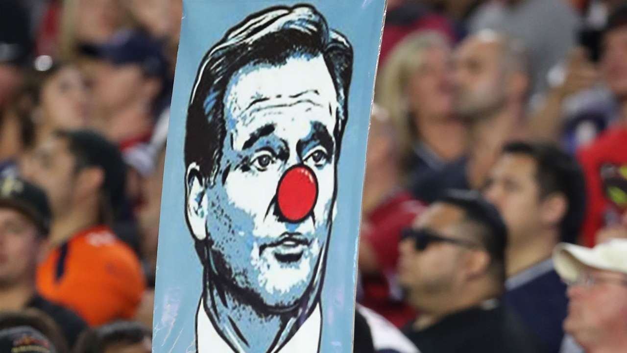 Fan holds up a NFL commissioner Roger Goodell sign during Patriots game