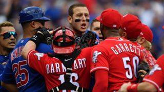 Cubs teammates hold back Anthony Rizzo (middle) and Javier Baez (far left) as they go after Reds reliever Amir Garrett (50).