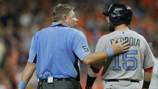 Dustin Pedroia, right, and umpire Greg Gibson