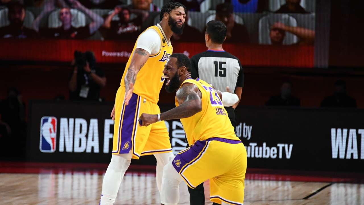 LeBron James and Anthony Davis celebrate at the buzzer after the LA Lakers' game four win.