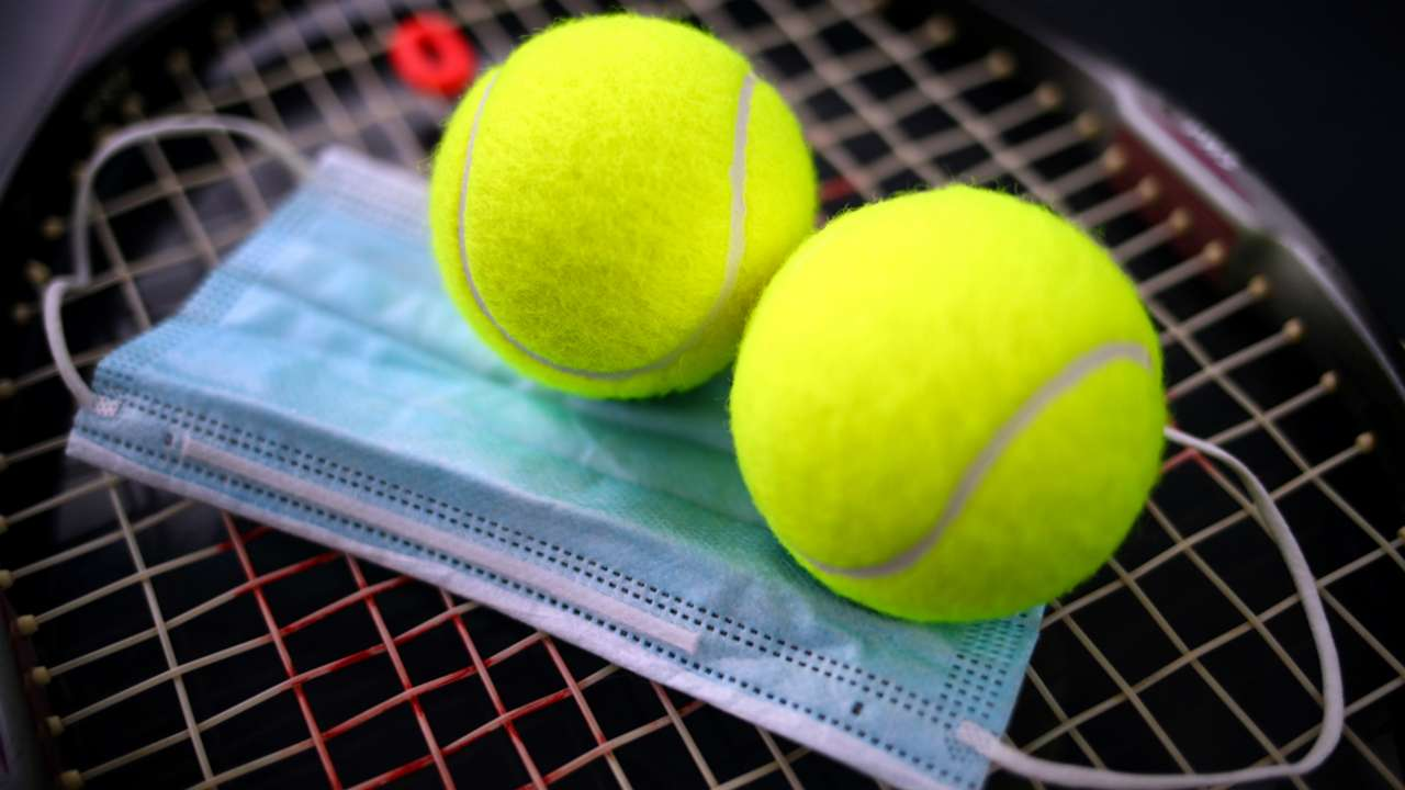 Tennis balls and face mask - cropped