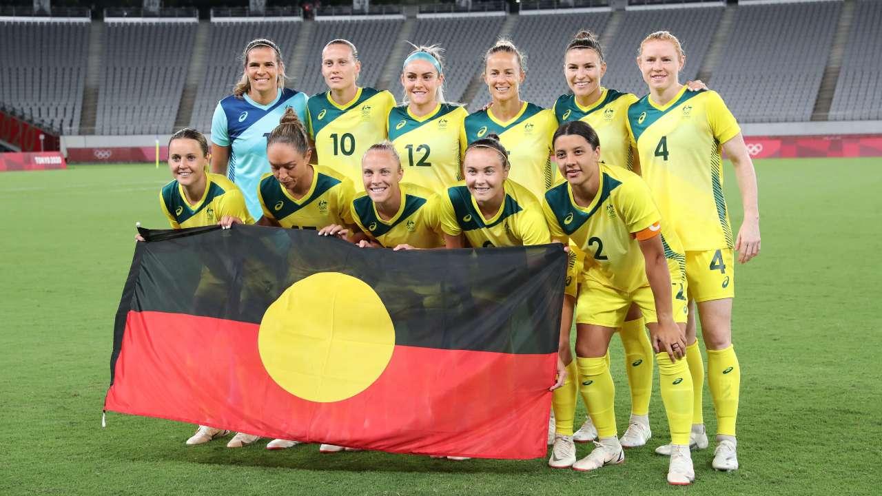 Matildas with Aboriginal flag