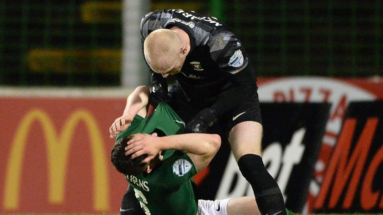 Irish goalkeeper Aaron McCarey sent off after attacking own teammate and former A-League player Bobby Burns