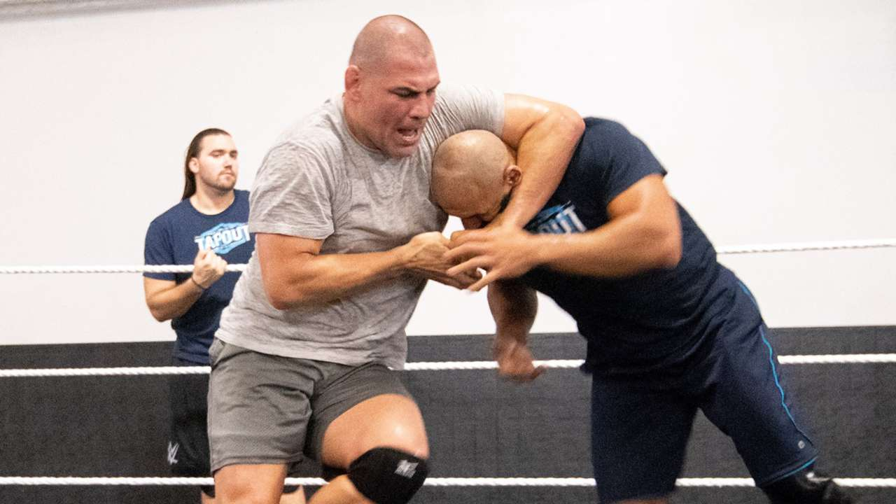 The two-time UFC Heavyweight Champion seemed to take to the squared circle like a fish to water.
