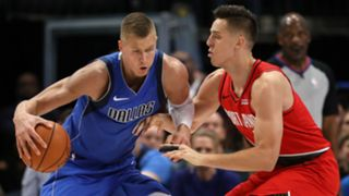 kristaps-porzingis-zach-collins-getty-122719-ftr.jpg