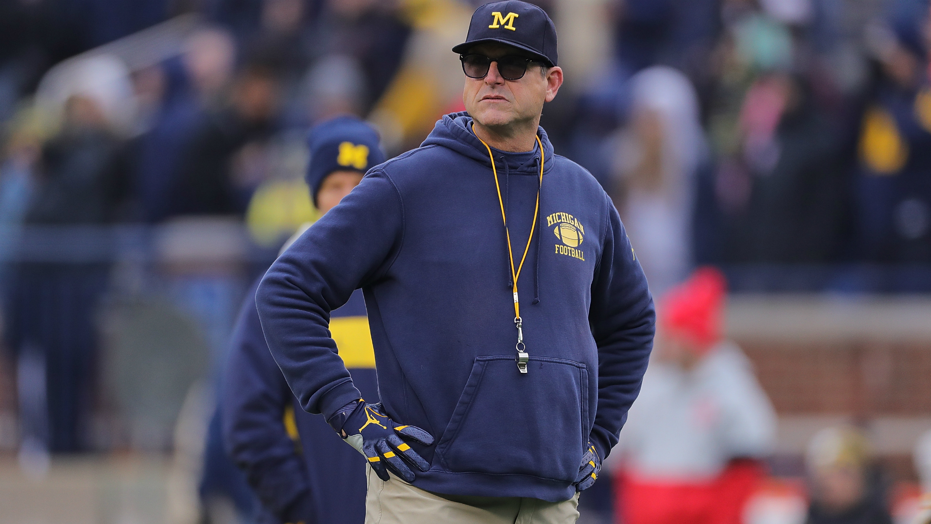 Michigan coach Jim Harbaugh marches in Ann Arbor protest 1