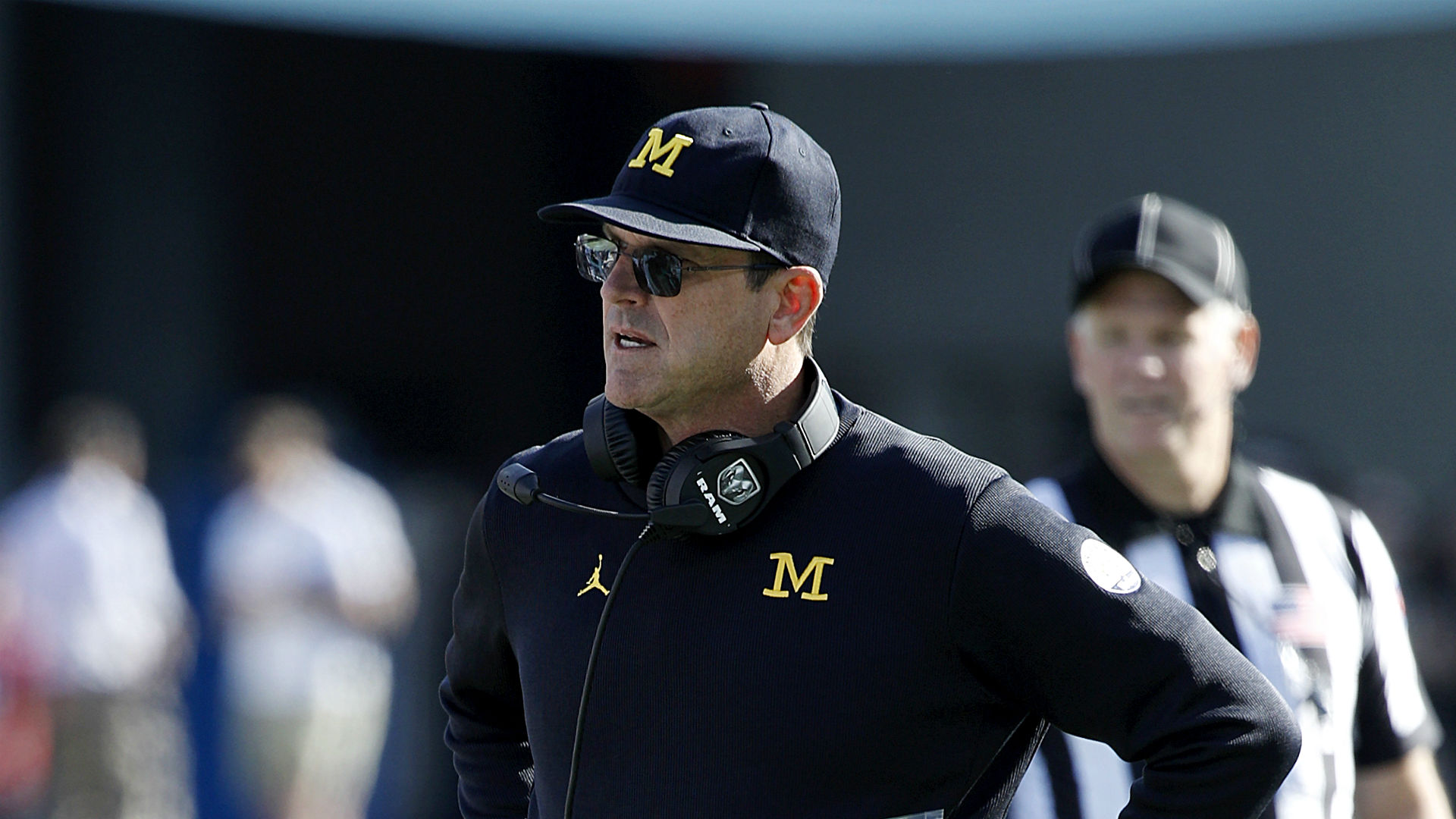Jim Harbaugh, Michigan coaches perform cartwheel over linebacker commitment