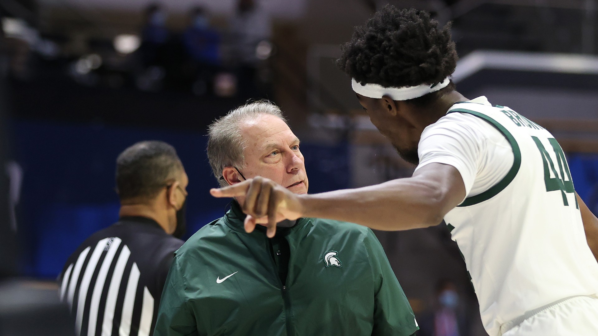 Michigan State's Tom Izzo and Gabe Brown exchanged during the break of the first four games